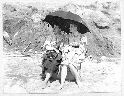 Sr_np_003_-_box_1_folder_3_-_helena_born_and_hmt_under_umbrella_on_beach_1896_copy-515fcbee1ad69acc2a781a1158b0a495-